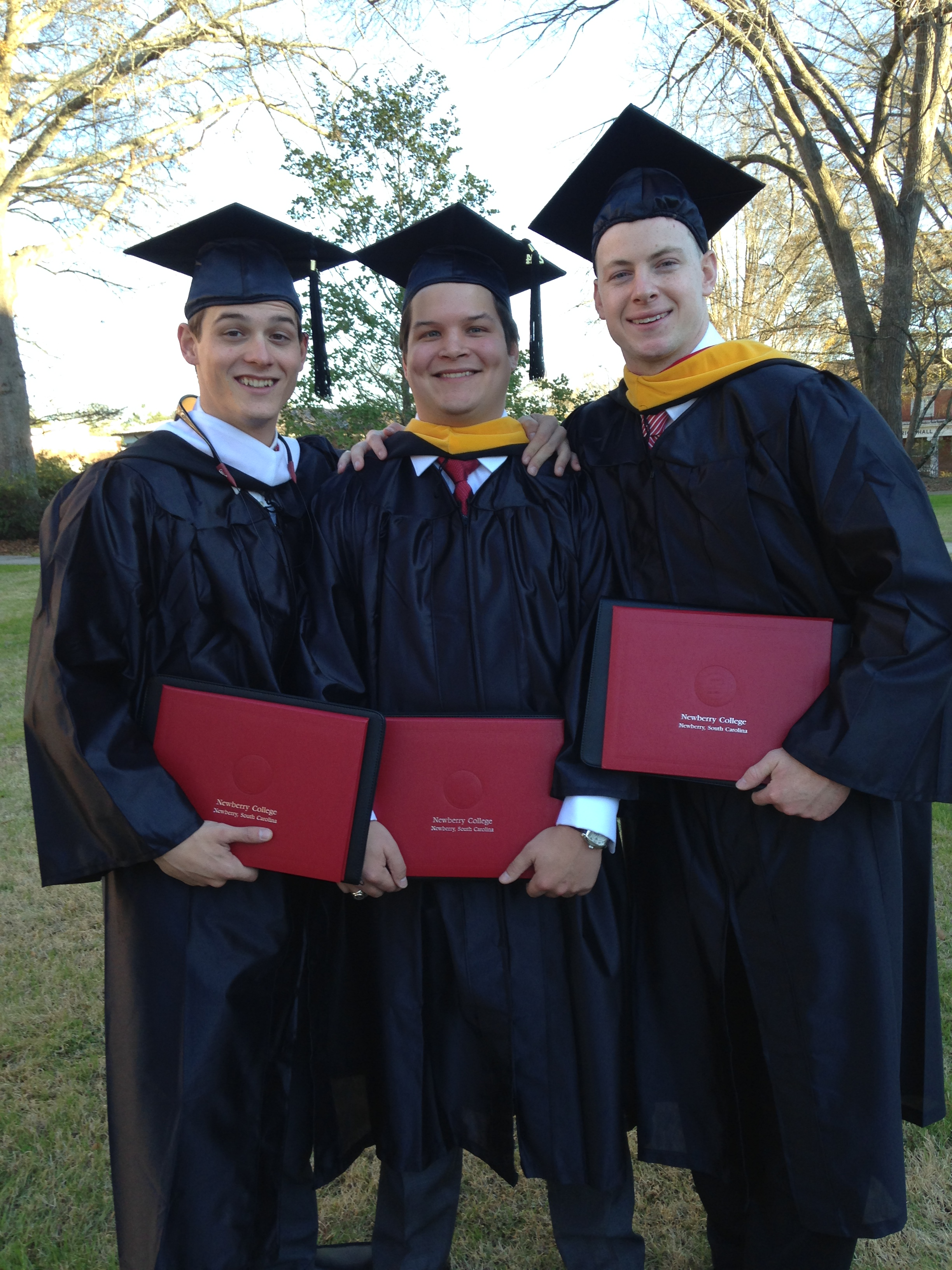 Three become Delta Epsilon Alumni